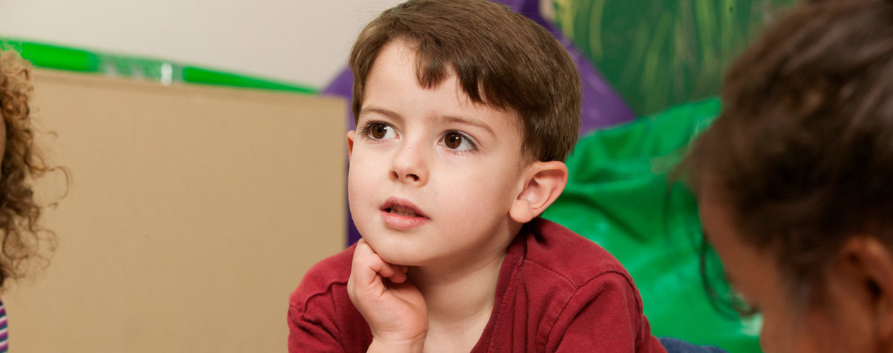 A boy look pensive during a lesson.