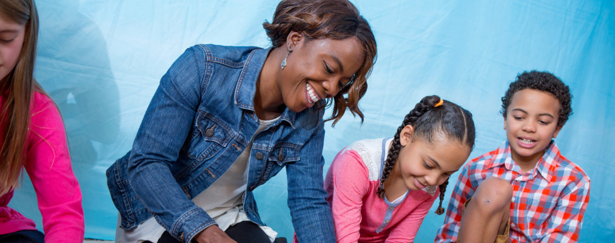 A mom, son, and daughter participate in a family ministry activity.
