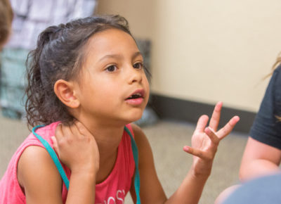 A little girl asks a question during a lesson on Cain and Abel.