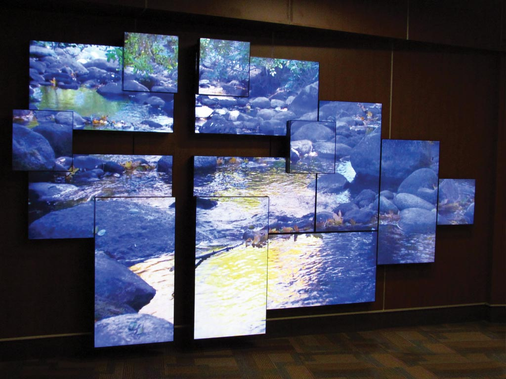 Television screens aligned to make a beautiful river, flowing across the screens.