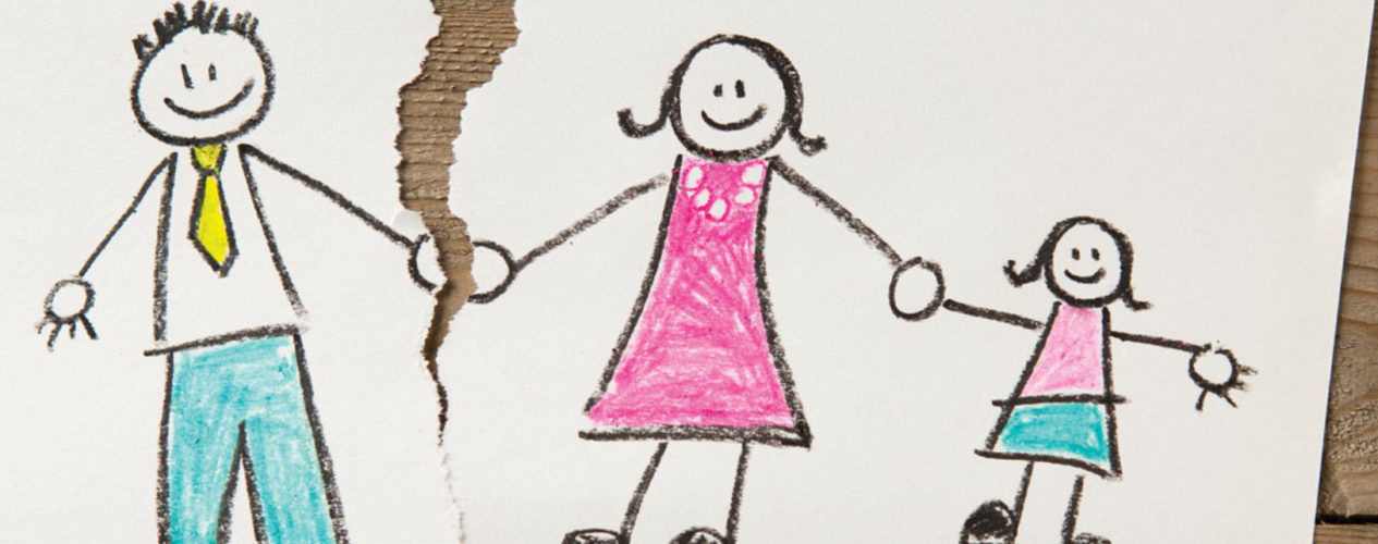 A kid's drawing of a stick figure mom, dad, and daughter, holding hands. The paper is torn between the mom and dad.
