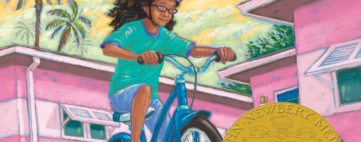 """The book cover for Merci Suarex Changes Gears. It has a John Newberry Medal on it the cover. It reads """"Pura Belpre Award-winning author, Meg Medina."""" It also has a quote that from Robin Yardi, that says, """"Meg Medina is the Judy Blume for a new generation."""" On the cover is an illustrated girl riding her bike."""
