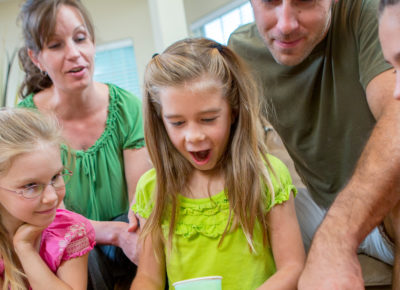 family excited about what girl in yellow is doing